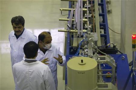 A technician explains the workings of a machine to a government visitor during the inauguration of the Fuel Manufacturing plant at the Isfahan Uranium Conversion Facility 440 kilometres (274 miles) south of Tehran April 9, 2009. REUTERS/Caren Firouz