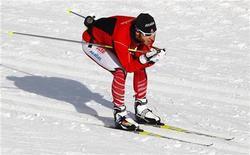 <p>Канадский лыжник Брайан Маккивер на тренировке в провинции Альберта, Канада 3 февраля 2010 года. Практически полностью слепой канадец Брайан Маккивер наконец сможет осуществить свою мечту и выступить на Олимпийских играх за сборную своей страны. REUTERS/Todd Korol</p>