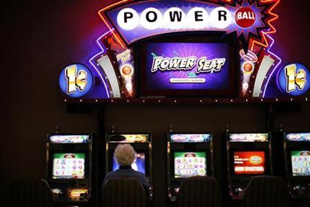 A woman plays a slot machine at the Island View Casino in Gulfport, Mississippi November 9, 2009. REUTERS/Carlos Barria