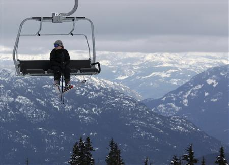 A skier sits on a chairlift over the downhill course of the Vancouver 2010 Winter Olympics in Whistler, British Columbia, February 7, 2010. REUTERS/Wolfgang Rattay
