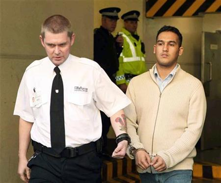 Scottish student Mohammed Atif Siddique (R) is led away handcuffed from the High Court of Scotland after being found guilty of terrorism charges in Edinburgh, Scotland October 23, 2007. REUTERS/David Moir