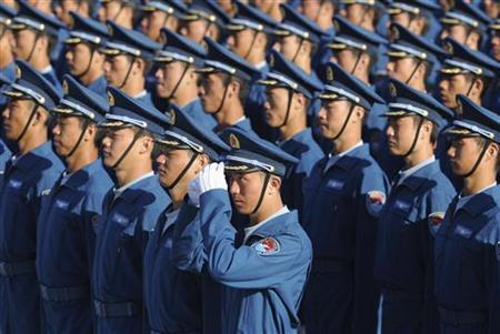 Members of the Chinese People's Liberation Army (PLA) Air Force Aviation stand at attention during a training session at the 60th National Day Parade Village in the outskirts of Beijing, September 15, 2009. REUTERS/Joe Chan