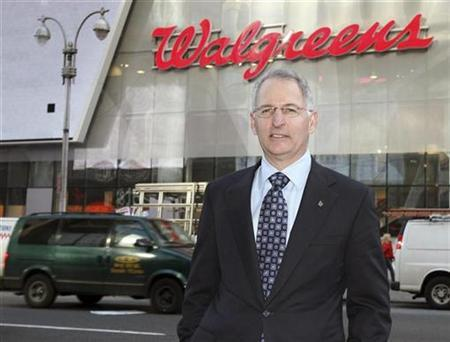 Greg Wasson, CEO of Walgreens, poses in front of the Walgreens flagship store in New York's Times Square, November 19, 2008. REUTERS/Brendan McDermid