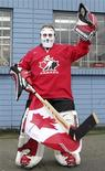 <p>A man wears a hockey goaltender's outfit while awaiting the Olympic torch relay to pass, before the Vancouver 2010 Winter Olympics February 12, 2010. REUTERS/Lyle Stafford</p>