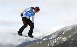 <p>Canada's Maelle Ricker competes during the women's snowboard cross semifinals at the Vancouver 2010 Winter Olympics, February 16, 2010. REUTERS/Mike Blake</p>