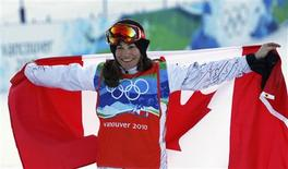 <p>Canada's Maelle Ricker celebrates after winning the gold medal in the women's snowboard cross at the Vancouver 2010 Winter Olympics February 16, 2010. REUTERS/Mark Blinch</p>