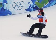 <p>Canada's Maelle Ricker celebrates after crossing the finish line during the women's snowboard cross finals at the Vancouver 2010 Winter Olympics February 16, 2010. Ricker won the gold medal. REUTERS/Chris Helgren</p>