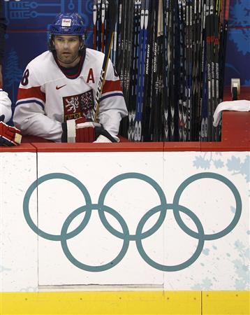 Jaromir Jagr of the Czech Republic sits on the bench during their men's hockey game against Slovakia at the Vancouver 2010 Winter Olympics, February 17, 2010. REUTERS/Hans Deryk