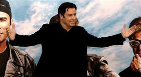 """<p>Американский актер Джон Траволта во время фотосессии, посвященной выходу фильма """"Реальные кабаны"""", Мадрид, 27 марта 2007 года. Некоторые важные исторические события, произошедшие в этот день, 18 февраля. REUTERS/Sergio Perez</p>"""
