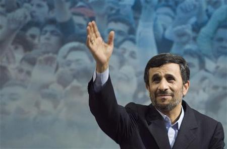 Iranian President Mahmoud Ahmadinejad waves to journalists after a news conference in Tehran February 16, 2010. REUTERS/Raheb Homavandi