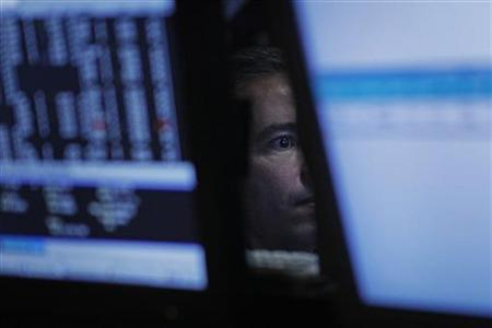 A trader works on the floor of the Stock Exchange in New York, December 2, 2009. REUTERS/Finbarr O'Reilly