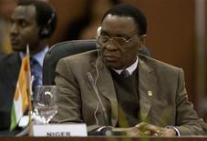 <p>Niger's President Mamadou Tandja attends the plenary session of the Africa-South America Summit in Margarita Island September 27, 2009. REUTERS/Carlos Garcia Rawlins</p>