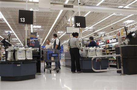 Customers wait in the check-out lane at Wal-Mart in Phoenix, Arizona, February 18, 2010. REUTERS/Joshua Lott