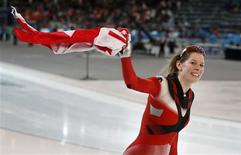<p>Christine Nesbitt of Canada celebrates winning the women's 1000 metres speed skating race at the Richmond Olympic Oval during the Vancouver 2010 Winter Olympics February 18, 2010. REUTERS/Jerry Lampen</p>