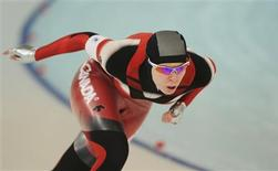 <p>Canada's Christine Nesbitt competes in the women's 1000 metres speed skating race at the Richmond Olympic Oval during the Vancouver 2010 Winter Olympics February 18, 2010. REUTERS/Dylan Martinez</p>