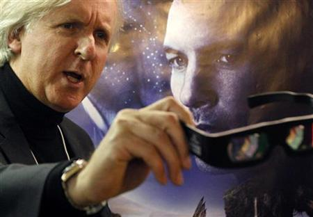 Canadian director James Cameron shows 3D glasses as he poses in front of a poster before a promotion event for his latest movie Avatar at the World Economic Forum (WEF), in Davos January 28, 2010. REUTERS/Christian Hartmann