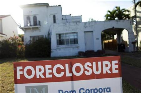 A foreclosure sale sign sits in front of a house in Miami Beach, Florida February 27, 2009. REUTERS/Carlos Barria