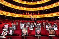 <p>Photographs of guests who will attend the BAFTA (British Academy of Film and Television Arts) awards ceremony on Sunday are placed on seats at the Royal Opera House in London February 18, 2010. REUTERS/Toby Melville</p>
