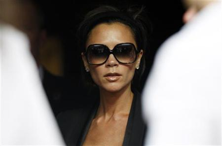 Victoria Beckham is pictured before the start of the Italian Serie A soccer match between AC Milan and Juventus at the San Siro stadium in Milan May 10, 2009. REUTERS/Alessandro Garofalo