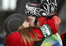 <p>Canada's Jon Montgomery (R) is kissed by his girlfriend Darla Deschamps after winning a gold medal in the men's skeleton event at the Vancouver 2010 Winter Olympics in Whistler, British Columbia, February 19, 2010. REUTERS/Tony Gentile</p>