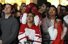 <p>Hockey fans watch a broadcast from the streets of downtown Vancouver as the Canadian men's hockey team plays the United States men's team during the Vancouver 2010 Winter Olympics February 21, 2010. Team USA won the game 5-3. REUTERS/Mike Blake</p>