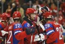 <p>Alex Ovechkin (C) of Russia celebrates their win over the Czech Republic with teammates in their hockey game at the Vancouver 2010 Winter Olympics, February 21, 2010. REUTERS/Hans Deryk</p>