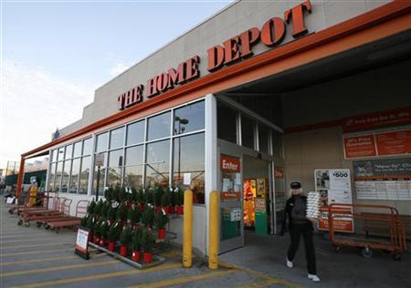 A shopper walks out of a Home Depot store in Alexandria, Virginia, November 17, 2009. REUTERS/Molly Riley