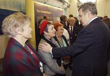 <p>Britain's Prime Minister Gordon Brown (R) meets with women who were migrant children, (L-R) Jean Costello, Mary Johnston and Anne McVeigh at Portcullis House in London February 24, 2010. REUTERS/Peter Macdiarmid/Pool</p>
