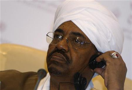 Sudanese President Omar al-Bashir attends a news conference after the signing of an agreement in Doha February 23, 2010. REUTERS/Mohammed Dabbous
