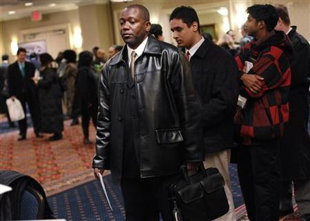 A man waits to have his resume critiqued for free at the NYCHires Job Fair in New York February 24, 2010. REUTERS/Shannon Stapleton