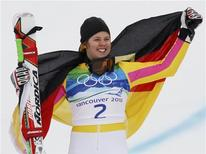 <p>Gold medallist Germany's Viktoria Rebensburg holds a national flag as she celebrates on the podium during the flower ceremony for the women's alpine skiing giant slalom event at the Vancouver 2010 Winter Olympics in Whistler, British Columbia, February 25, 2010. REUTERS/Leonhard Foeger</p>