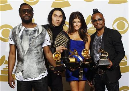 Black Eyed Peas' (from L to R) will.i.am, Taboo, Fergie, and apl.de.ap pose with their Grammy awards at the 52nd annual Grammy Awards in Los Angeles January 31, 2010. REUTERS/Lucy Nicholson