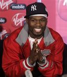 """<p>Рэпер 50 Cent улыбается во время пресс-конференции в аэропорту Йоханнесбурга 30 апрля 2008 года. Бывшая подружка хип-хоп исполнителя Рика Росса подала в суд на рэпера 50 Cent за то, что тот без ее ведома выложил в интернет ее """"домашнее видео"""". REUTERS/Siphiwe Sibeko</p>"""