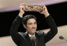 "<p>French actor Tahar Rahim poses with his Best Actor award for the film ""Un Prophete"" (A Prophet) during the 35th Cesar Awards ceremony in Paris February 27, 2010. REUTERS/Victor Tonelli</p>"