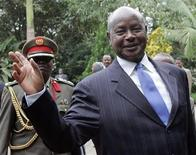 <p>Uganda's President Yoweri Museveni waves upon his arrival at Ngurdoto Mountain Lodge in Arusha May 22, 2008, where the twelve heads of States and Government meeting of the African Union is being held. REUTERS/Antony Njuguna</p>