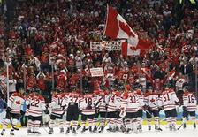 <p>The Canadian hockey team celebrates after defeating Russia in their men's ice hockey play-offs quarterfinals at the Vancouver 2010 Winter Olympics February 24, 2010. REUTERS/Hans Deryk</p>