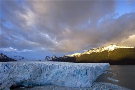 The sun rises over Argentina's Perito Moreno glacier near the city of El Calafate, in the Patagonian province of Santa Cruz, December 16, 2009. REUTERS/Marcos Brindicci/Files