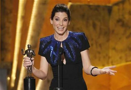 Actress Sandra Bullock accepts the award for best female actor in a leading role for ''The Blind Side'' at the 16th annual Screen Actors Guild Awards in Los Angeles January 23, 2010. REUTERS/Mike Blake
