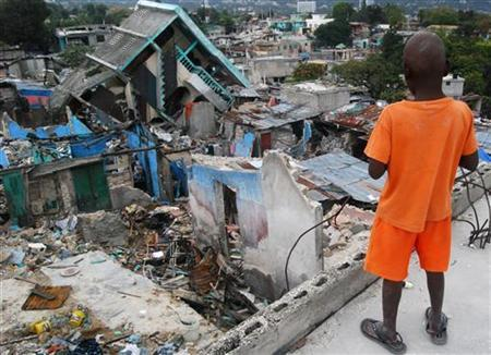 A boy looks at the ruins of his Fort National neighborhood in Port-au-Prince March 4, 2010. The neighborhood is one of the worst hit by the January 12 quake that killed 300,000 people, according to government estimates. Picture taken March 4, 2010. REUTERS/Matthew Bigg