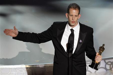 Pete Docter, director of ''Up,'' accepts the Oscar for best aninmated feature feature film during the 82nd Academy Awards in Hollywood March 7, 2010. REUTERS/Gary Hershorn