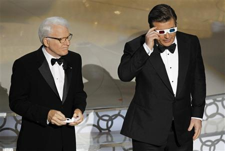 Actors Steve Martin (L) and Alec Baldwin host the 82nd Academy Awards in Hollywood March 7, 2010. REUTERS/Gary Hershorn (UNITED STATES)