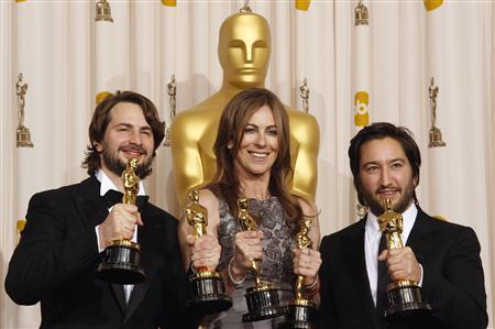 Best motion picture winners Mark Boal (L), Kathryn Bigelow (C) and Greg Shapiro of the film ''The Hurt Locker,'' display their Oscars at the 82nd Academy Awards in Hollywood March 7, 2010. REUTERS/Lucy Nicholson