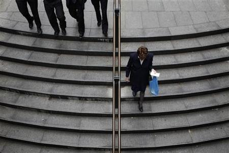 Office workers descend a set of stairs to a train station in central Sydney October 8, 2009. REUTERS/Tim Wimborne
