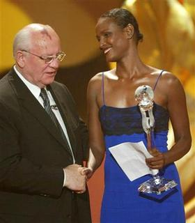 Waris Dirie (R) from Somalia receives the 'World Social Award' from the former president of the Soviet Union and president of the World Awards Mikhail Gorbvachev during the Women's World Awards gala in the northern German city of Hamburg June 9, 2004 file photo. REUTERS/Christian Charisius
