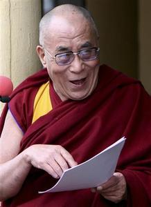 Exiled Tibetan spiritual leader the Dalai Lama smiles as he reads an annual statement during the 51st anniversary of the Tibetan uprising against Chinese rule, in the northern Indian hill town of Dharamsala March 10, 2010. REUTERS/Abhishek Madhukar