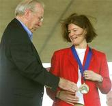 <p>Former shuttle astronaut Sally Ride (R) is congratulated by former Apollo 13 Commander James Lovell (L) after being inducted into the Astronaut Hall of Fame in Titusville, Florida on June 21, 2003 file photo. REUTERS/Charles W. Luzier</p>