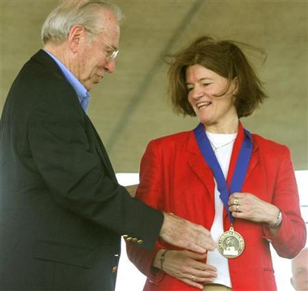 Former shuttle astronaut Sally Ride (R) is congratulated by former Apollo 13 Commander James Lovell (L) after being inducted into the Astronaut Hall of Fame in Titusville, Florida on June 21, 2003 file photo. REUTERS/Charles W. Luzier