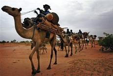 <p>A Tuareg caravan travels north through a remote region of southern Niger in this July 4, 2005 file photo. REUTERS/Finbarr O'Reilly/Files</p>