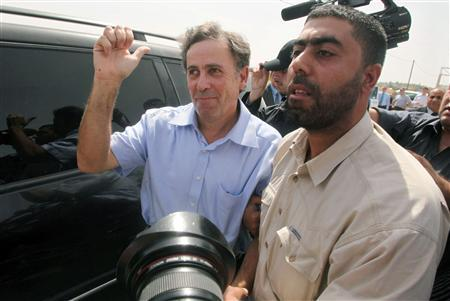 British journalist Paul Martin (L) gestures after he was released in Gaza March 11, 2010. REUTERS/Suhaib Salem
