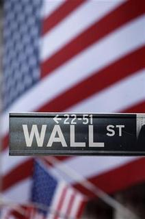 The Wall Street sign is seen in front of the New York Stock Exchange, October 8, 2009 file photo. REUTERS/Chip East